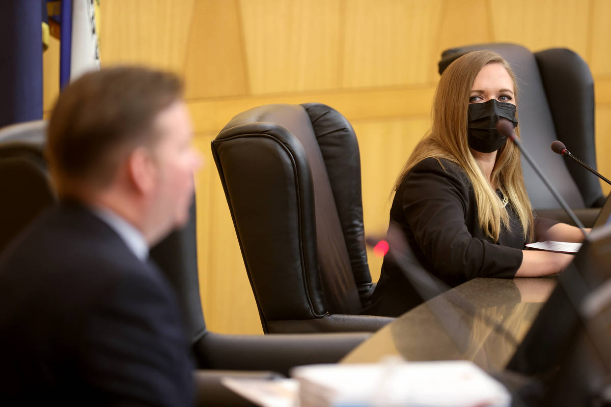 Presiding Officer Mandy McKellar listens to Metropolitan Police Department Detective Jason Leav ...