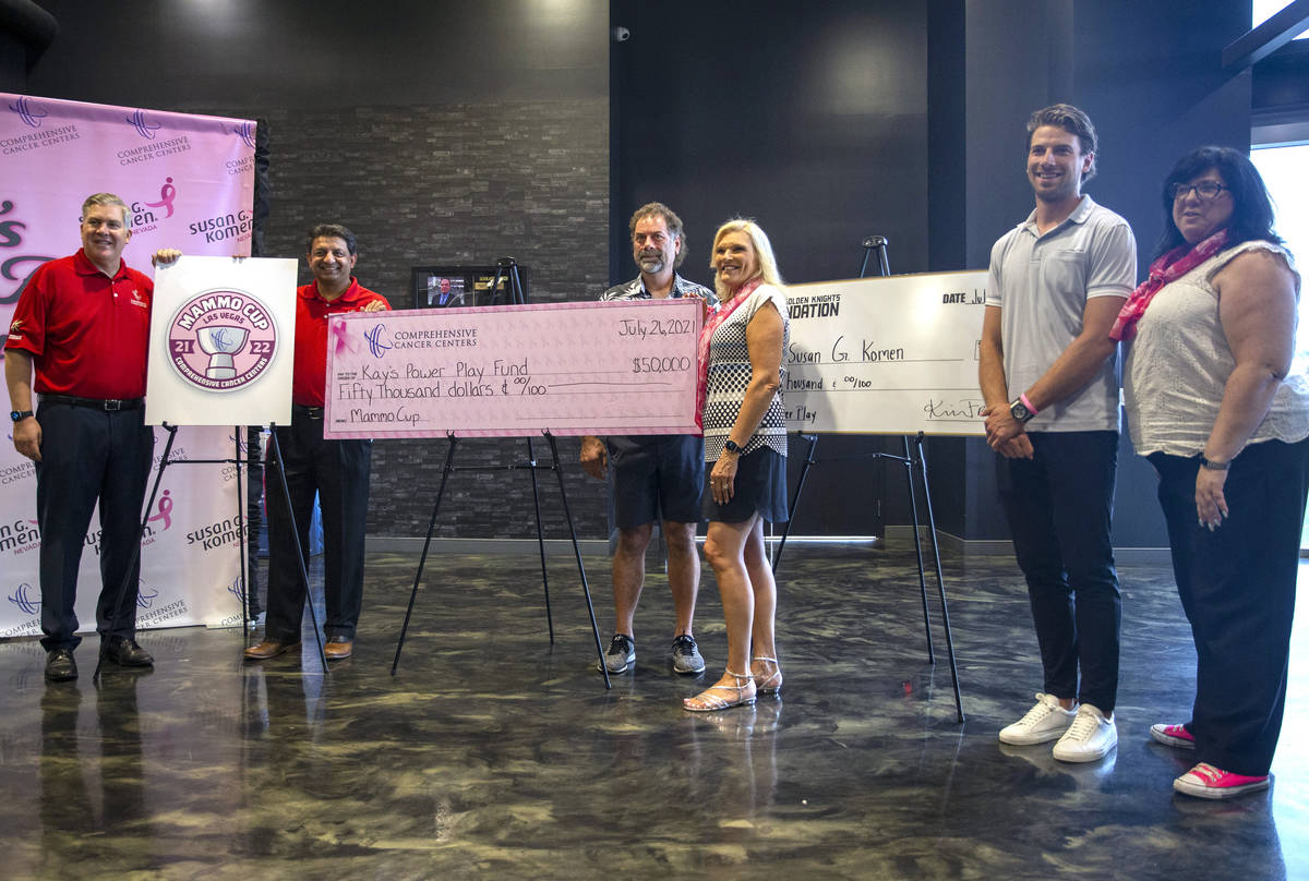 Vegas Golden Knights defenseman Shea Theodore, second from right, poses with, from left, Compre ...