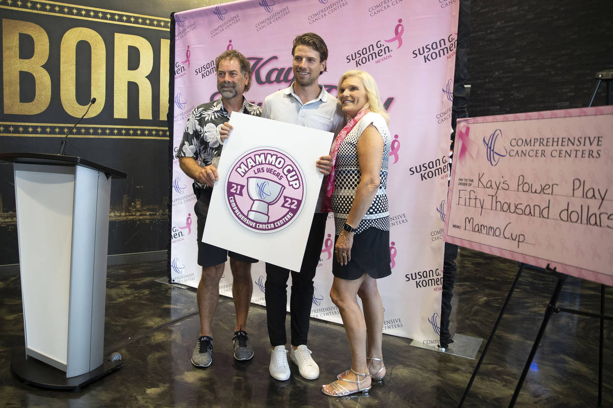 Vegas Golden Knights defenseman Shea Theodore, center, poses with his parents, Cam Theodore, le ...