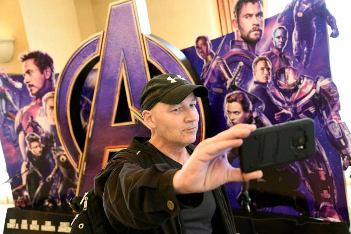 CinemaCon attendee Luis Saint Amant, of Argentina, takes a selfie in front of an advertisement ...