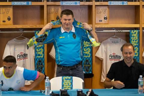 Las Vegas Lights owner Brett Lashbrook, center, with team player Daniel Crisostomo, left, and h ...