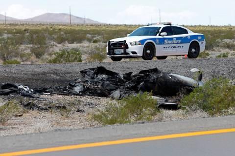 Law enforcement officers investigate a plane crash on U.S. Highway 95, around Nye County border ...