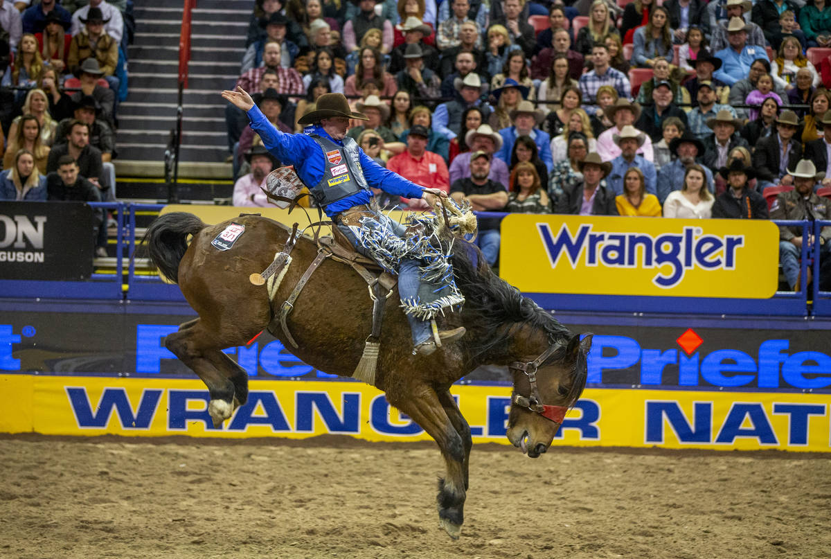 Spencer Wright of Milford, Utah, kicks back for the crowd in Saddle Bronc Riding at the tenth g ...