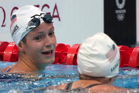 Katie Grimes, left, of the United States, talks with teammate Katie Ledecky, following their he ...