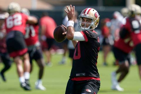 San Francisco 49ers quarterback Jimmy Garoppolo throws a pass at NFL football training camp in ...