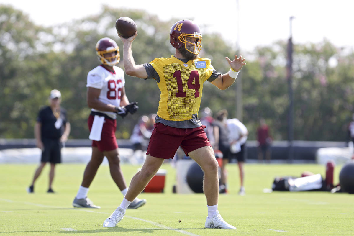 Washington Football Team quarterback Ryan Fitzpatrick (14) throws a pass during NFL football pr ...