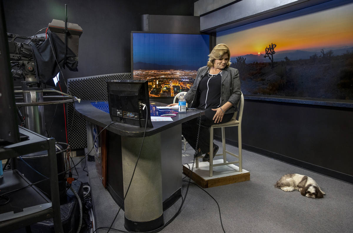 KPVM 25 News Director/Anchor Deanna O'Donnell looks her dog Tommy on set as she preps for her b ...