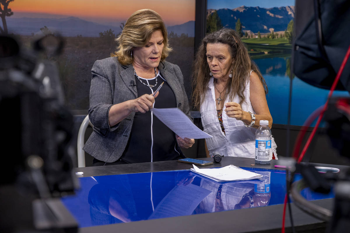 KPVM 25 News Director/Anchor Deanna O'Donnell, left, talk about some edits to her script with N ...