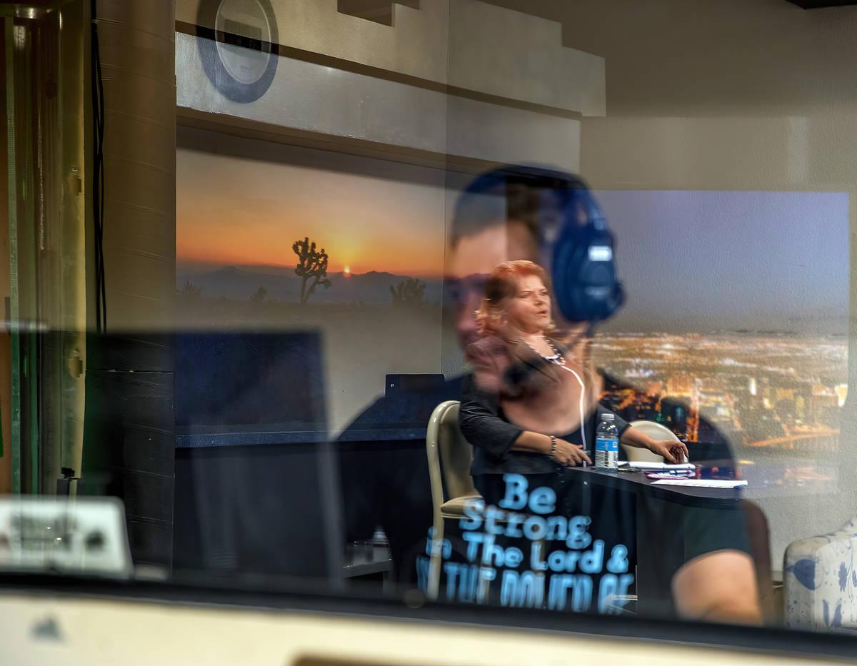 KPVM 25 Tech Coordinator Romano Frediani works in a control booth as News Director/Anchor Deann ...