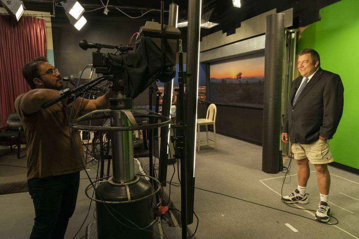 """John Kohler records a weather segment during a scene from the HBO docuseries """"Small Town News ..."""