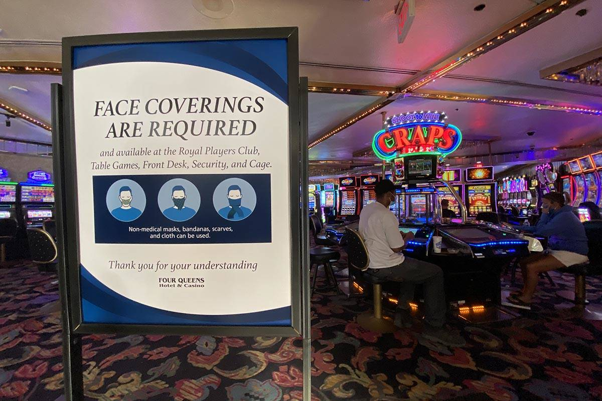 A sign notifying guests of face covering requirement at Four Queens in downtown Las Vegas Frida ...
