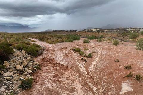 Flood waters along Charleston Boulevard near Red Rock Canyon National Conservation Area on Mond ...