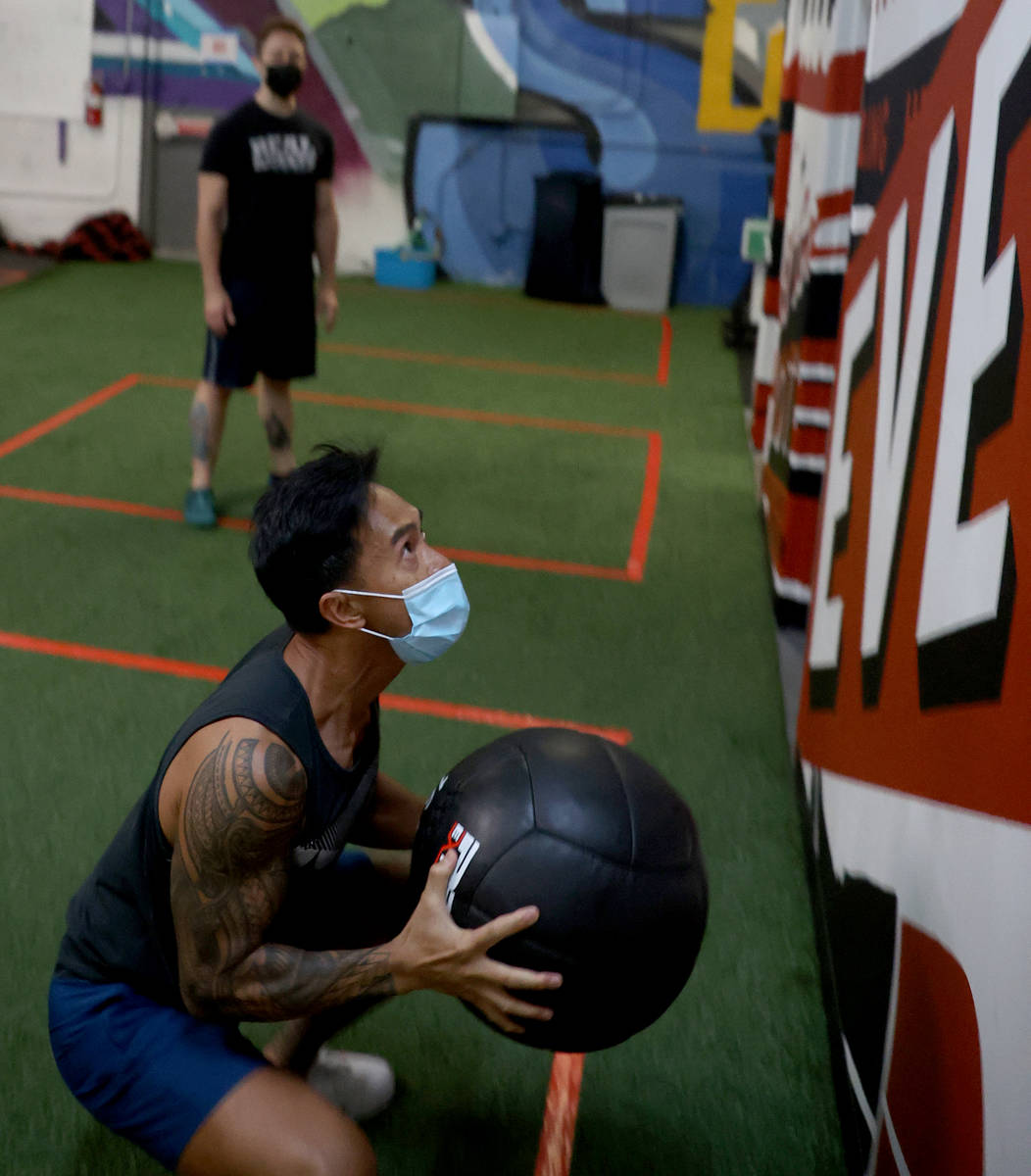 Bong Hidalgo works out with lead coach Michael Hayden at Real Results Fitness gym in downtown L ...