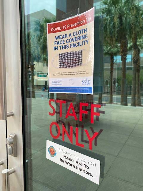 Signs at the Regional Justice Center in Las Vegas asking people to wear masks inside the buildi ...
