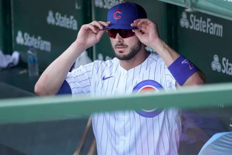 Chicago Cubs' Kris Bryant heads to the clubhouse after a 7-4 loss to the Cincinnati Reds in a b ...