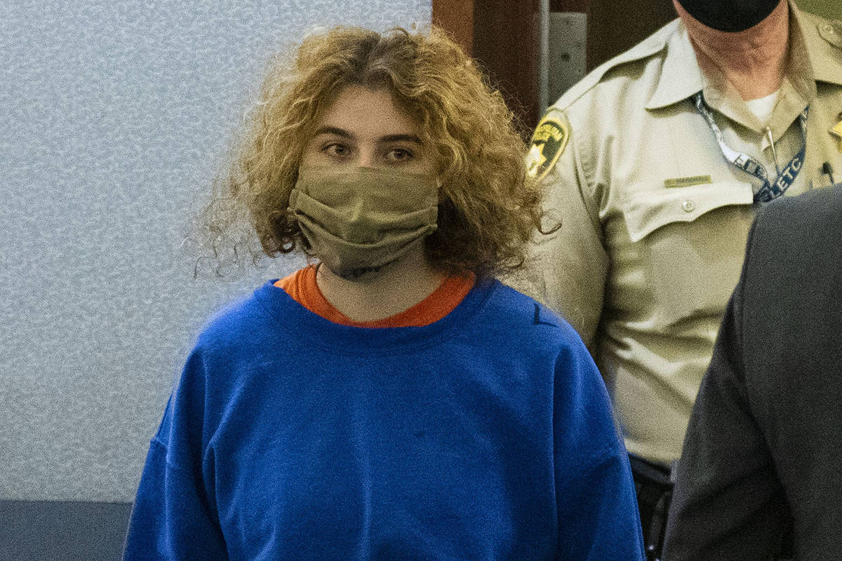 Sierra Halseth, charged in the killing of her father, Daniel, is led into the courtroom at the ...