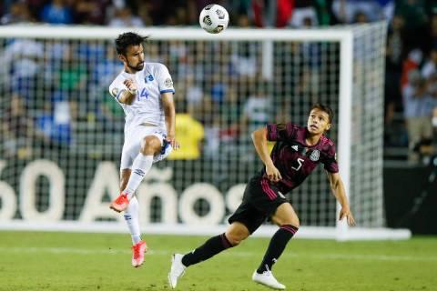 El Salvador forward Joaquin Rivas (14) and Mexico defender Osvaldo Rodriguez (5) vie for the ba ...