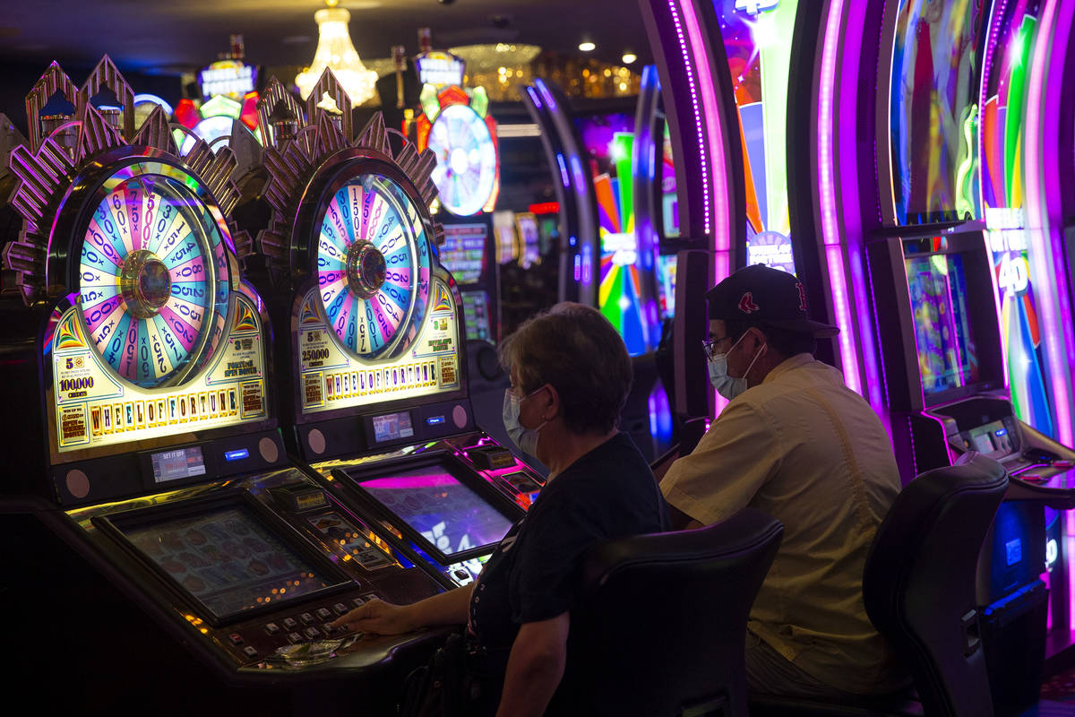 Gamblers try their luck in the Wheel of Fortune slots zone at the Plaza Hotel and Casino on Fri ...