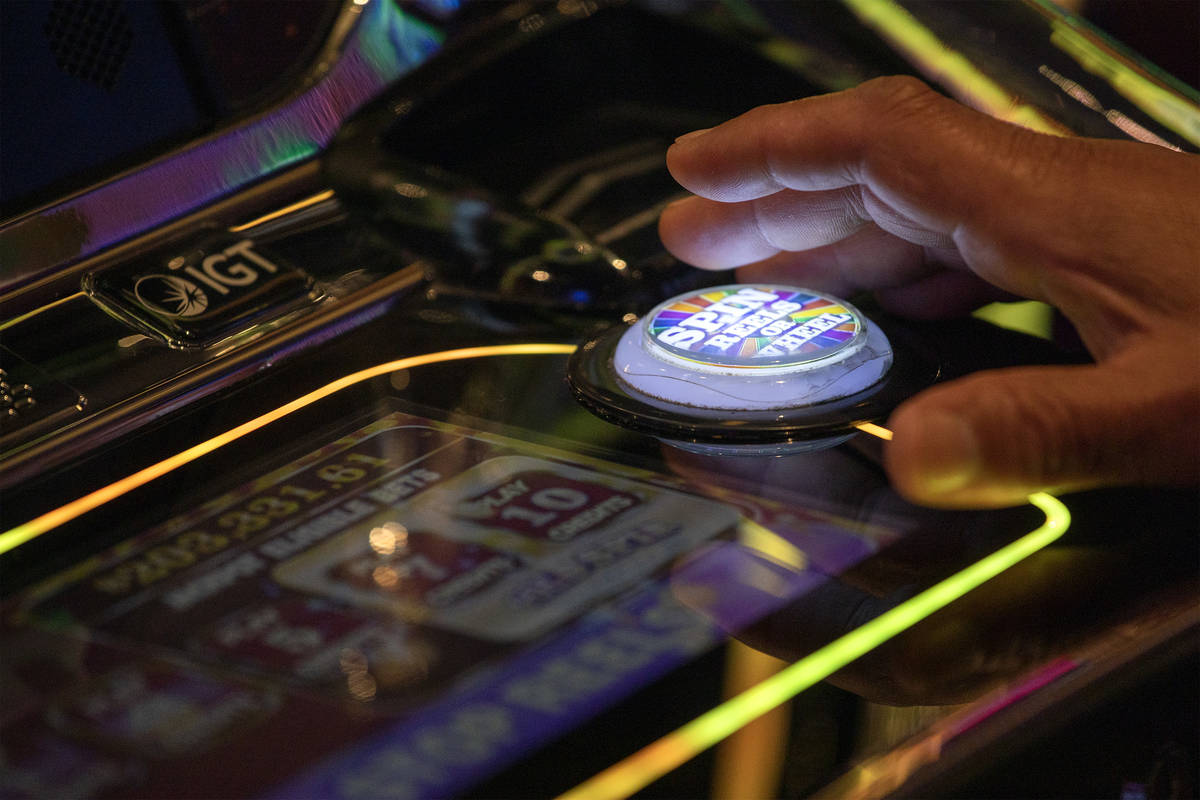 One gambler spins the wheel in the Wheel of Fortune slots zone at the Plaza Hotel and Casino on ...