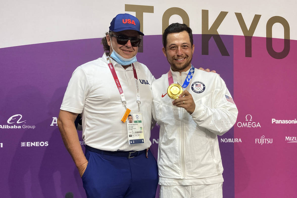 Xander Schauffele, of the United States, poses with his gold medal in the men's golf event with ...