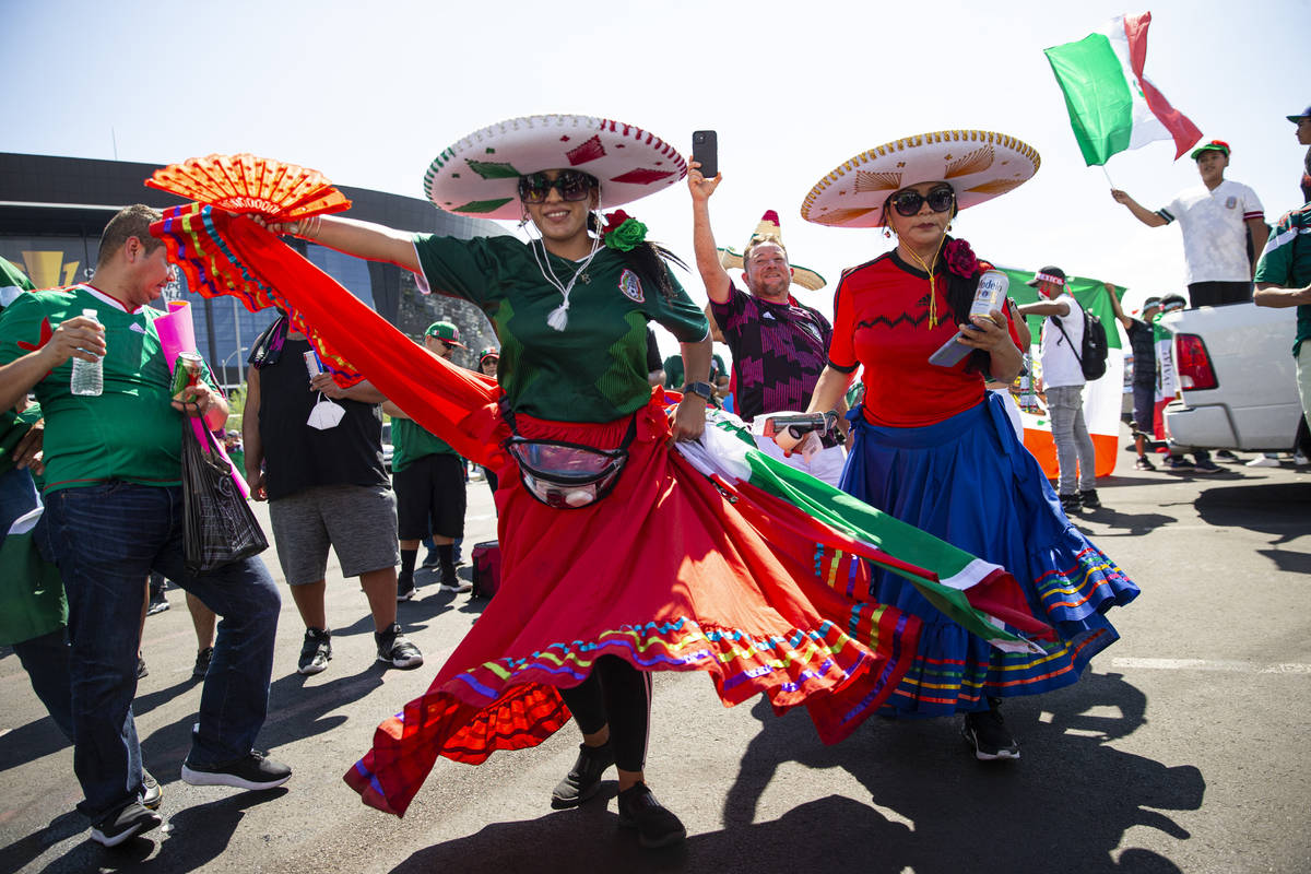 Mexico fans celebrate and dance before the Concacaf Gold Cup final soccer match at Allegiant St ...