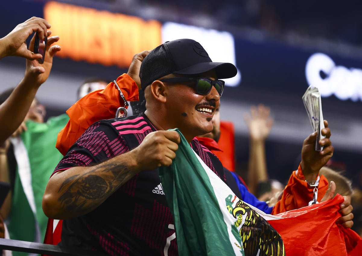 A Mexico fan cheers during the first half of the Concacaf Gold Cup final soccer match against t ...