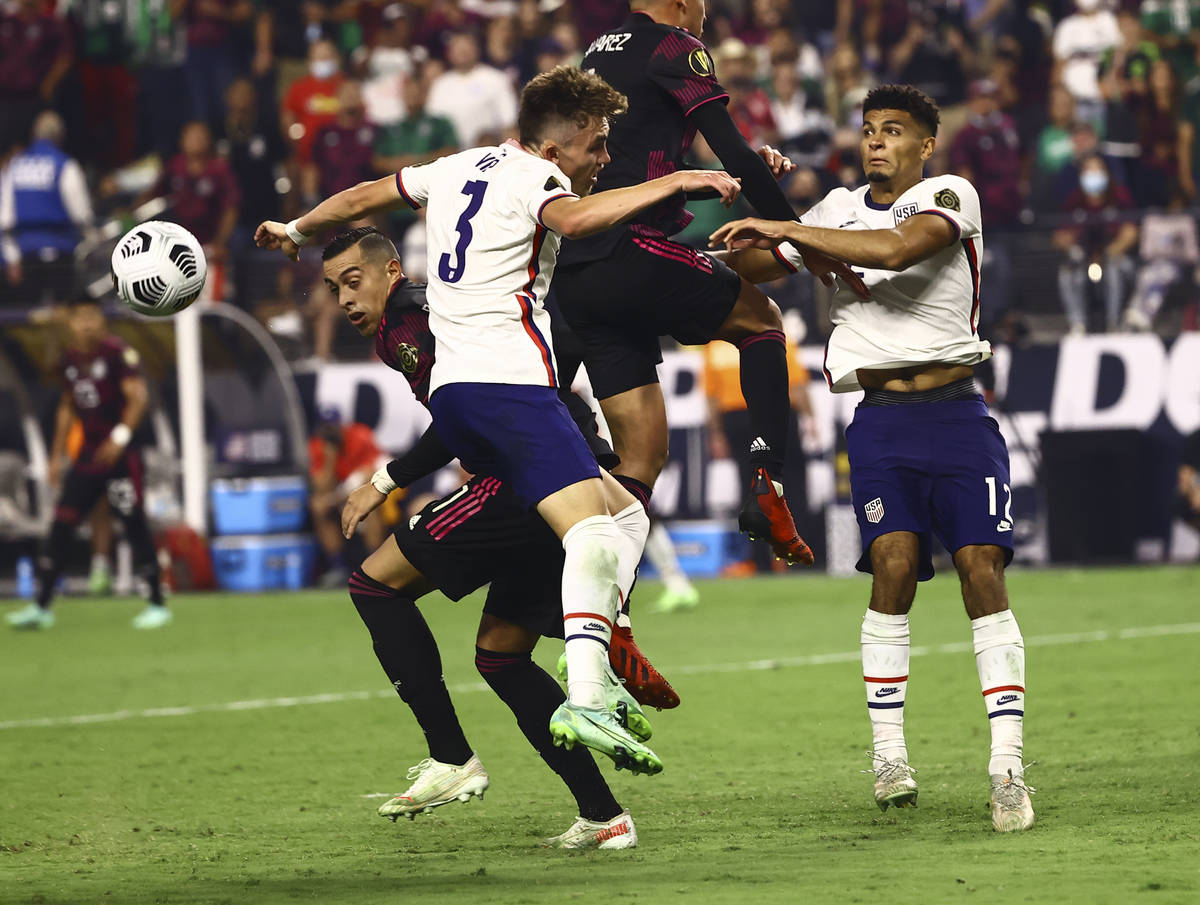 United States defenders Sam Vines (3) and Miles Robinson (12) battle for possession of the ball ...