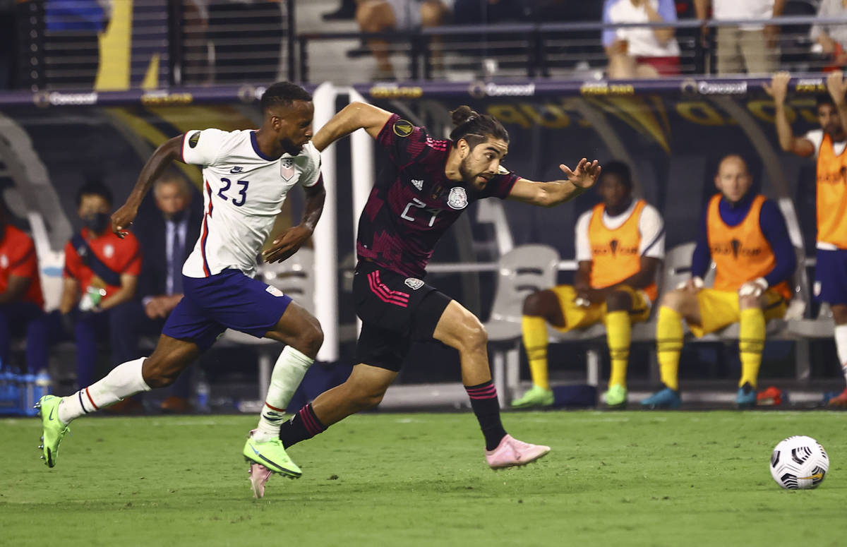 United States midfielder Kellyn Acosta (23) and Mexico forward Rodolfo Pizarro (24) chase after ...