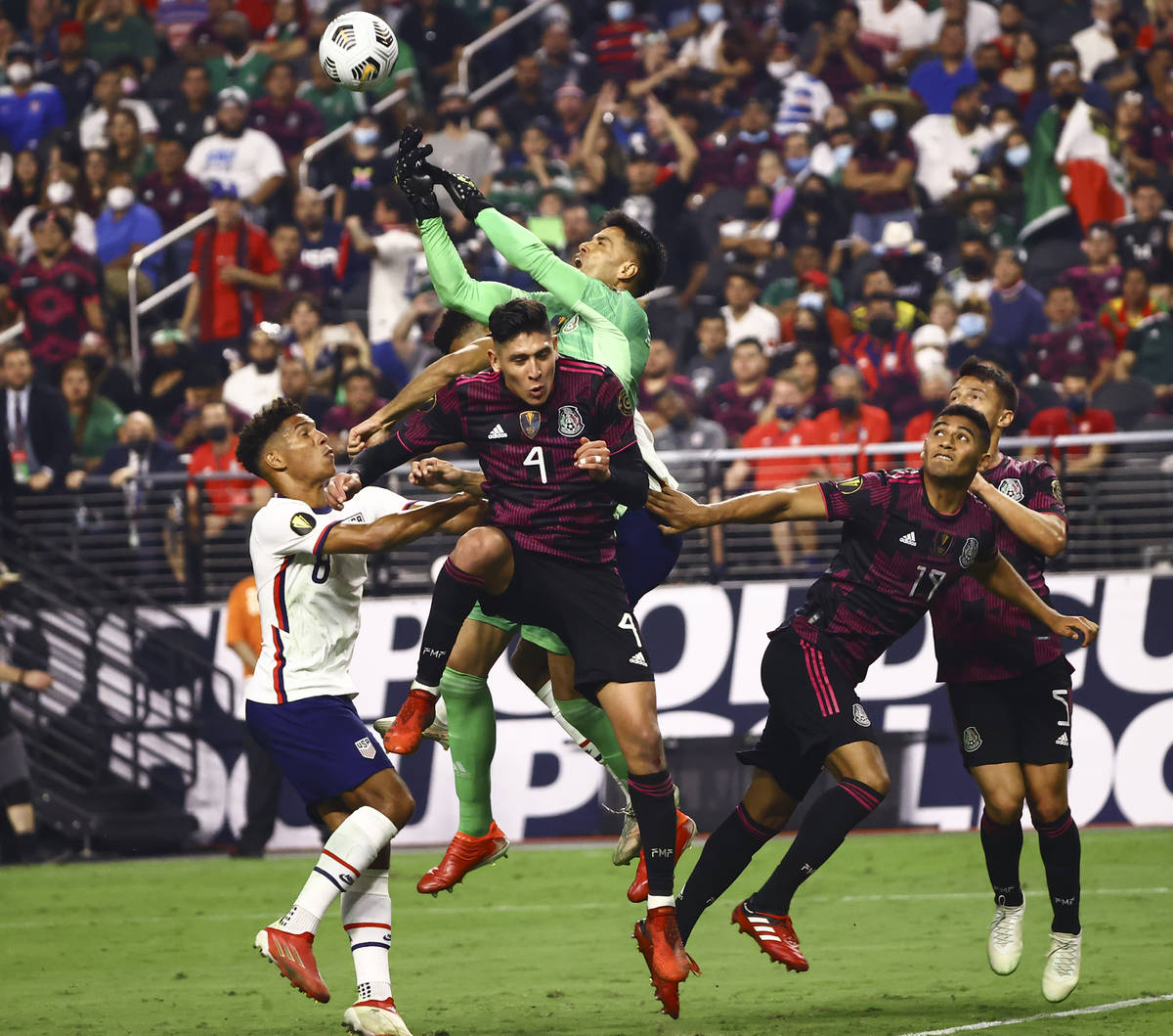 Mexico goalkeeper Alfredo Talavera blocks the ball between United States forward Nicholas Gioac ...