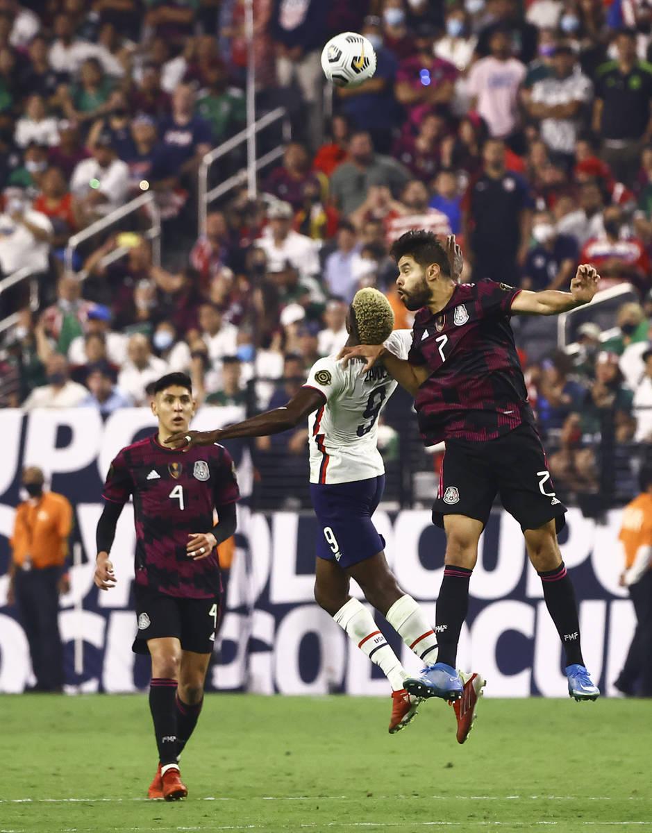 United States forward Gyadi Zardes (9) and Mexico defender Nestor Araujo (2) go up for a header ...