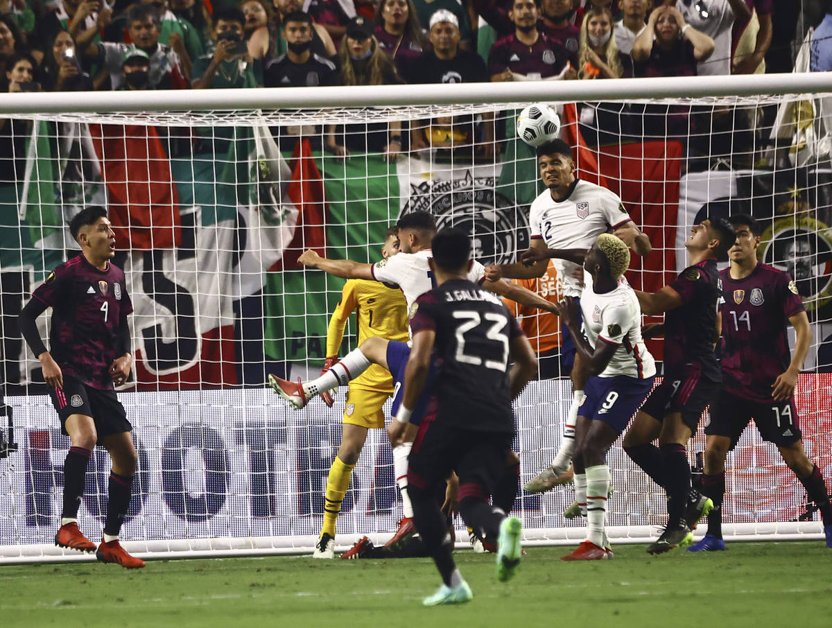 United States defender Reggie Cannon (2) heads the ball against Mexico during extra time in the ...