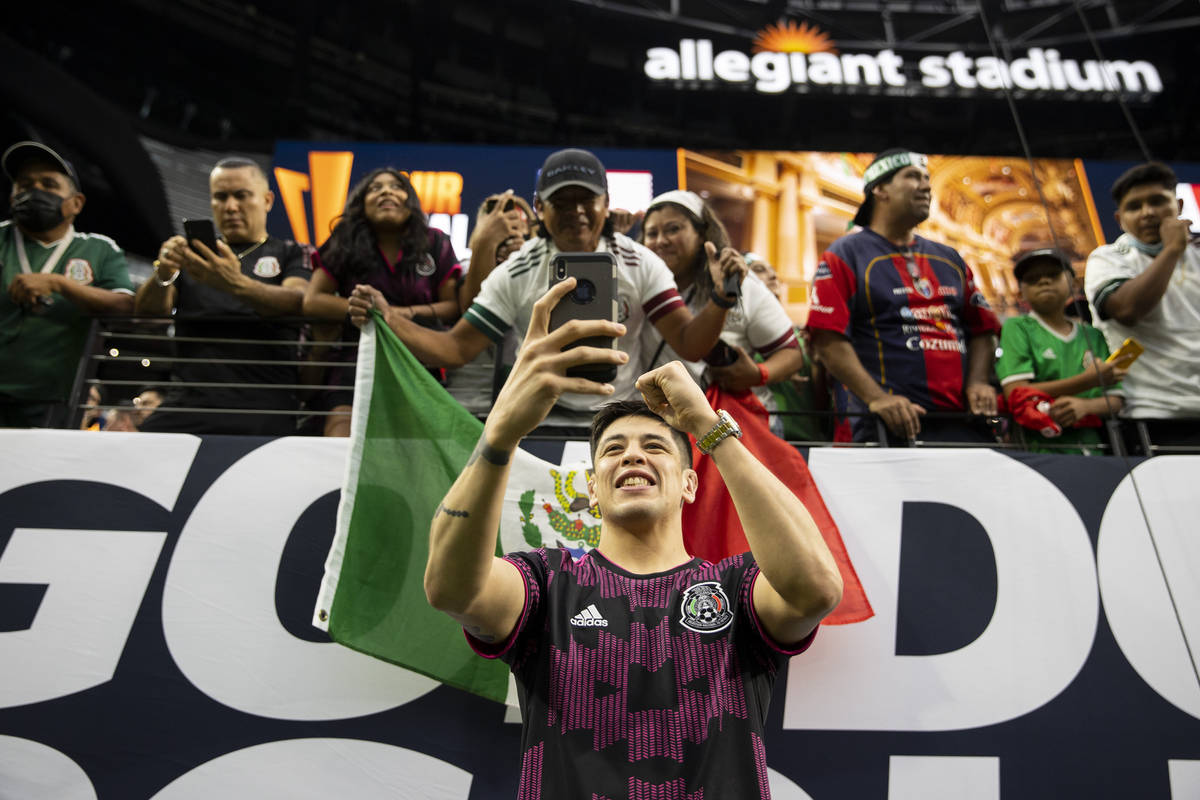 UFC flyweight champion Brandon Moreno takes photos with fans before the start of the Concacaf G ...
