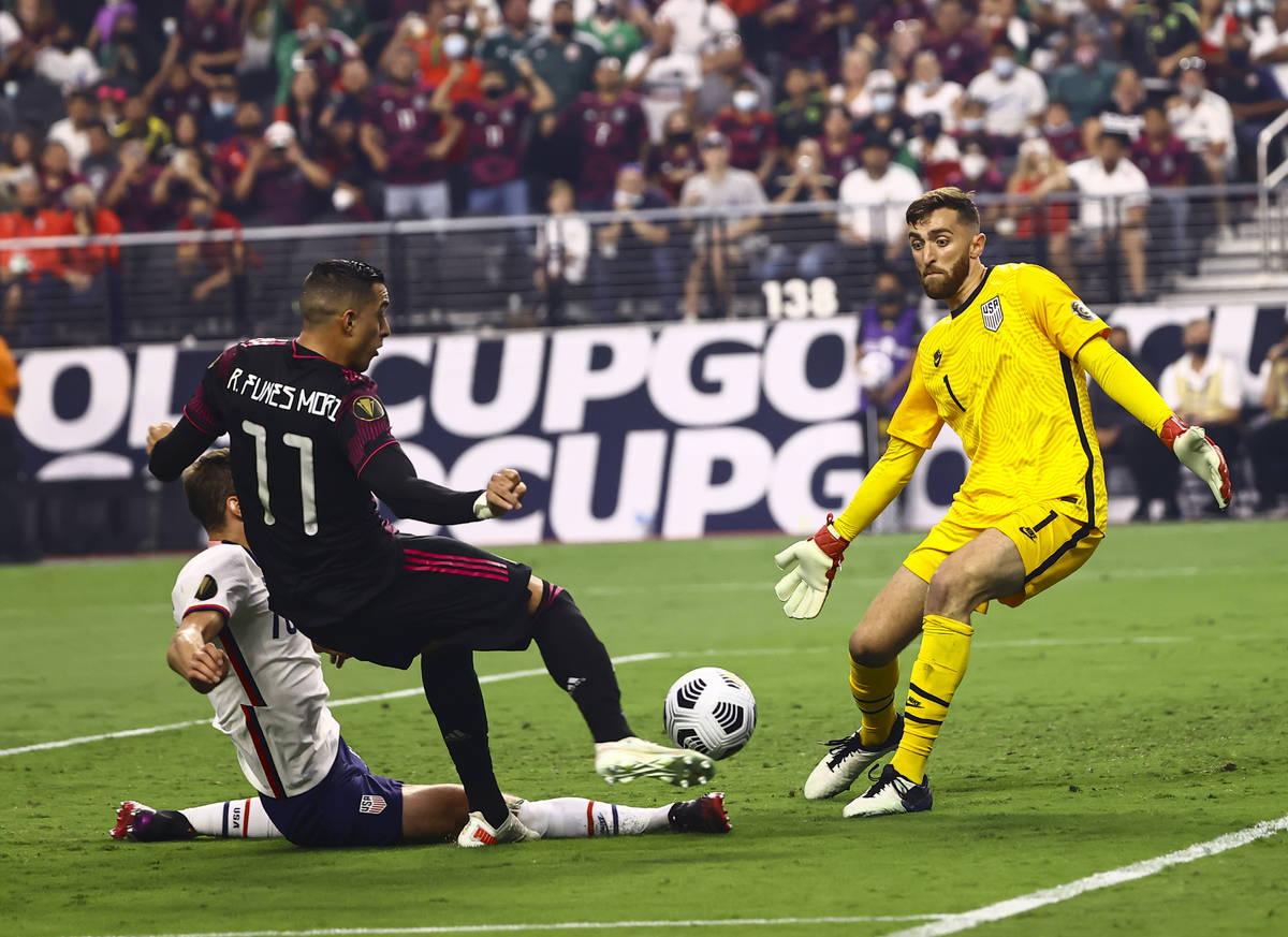 United States goalkeeper Matt Turner (1) blocks an attempt by Mexico forward Rogelio Funes Mori ...