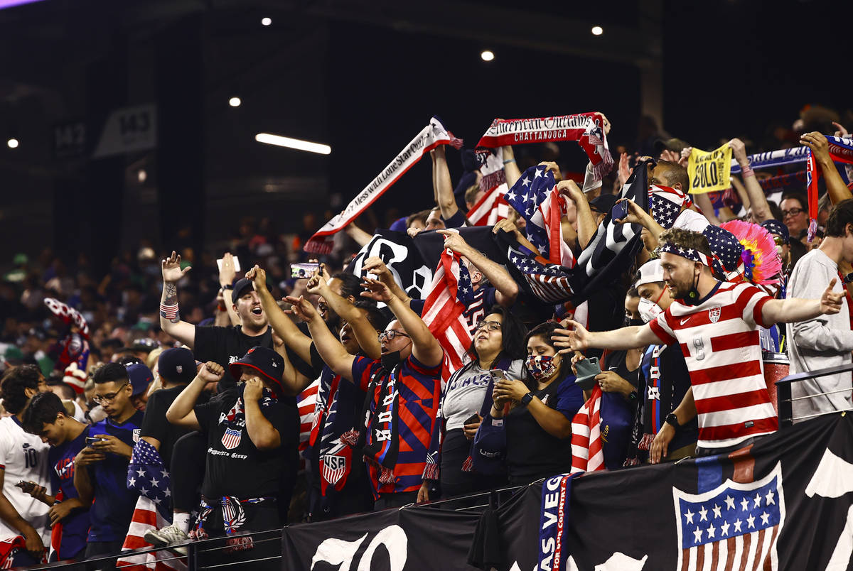 United States fans celebrate after the U.S. defeated Mexico 1-0 in extra time to win the Concac ...
