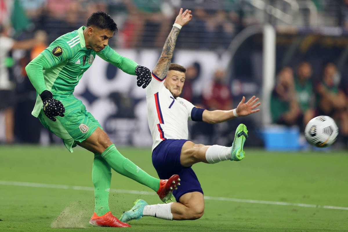 Mexico goalkeeper Alfredo Talavera clears the ball under pressure from United States forward Pa ...