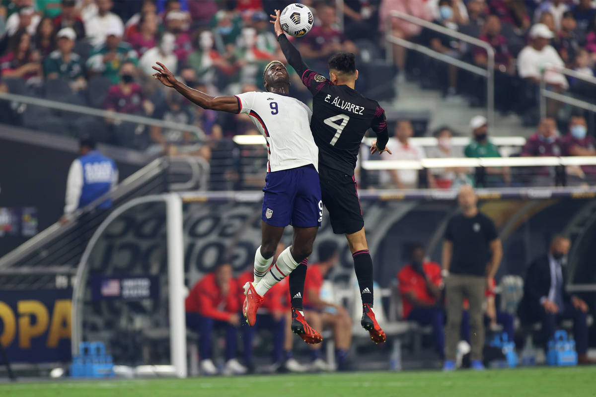United States forward Gyadi Zardes (9) and Mexico defender Edson Alvarez battle for the ball du ...