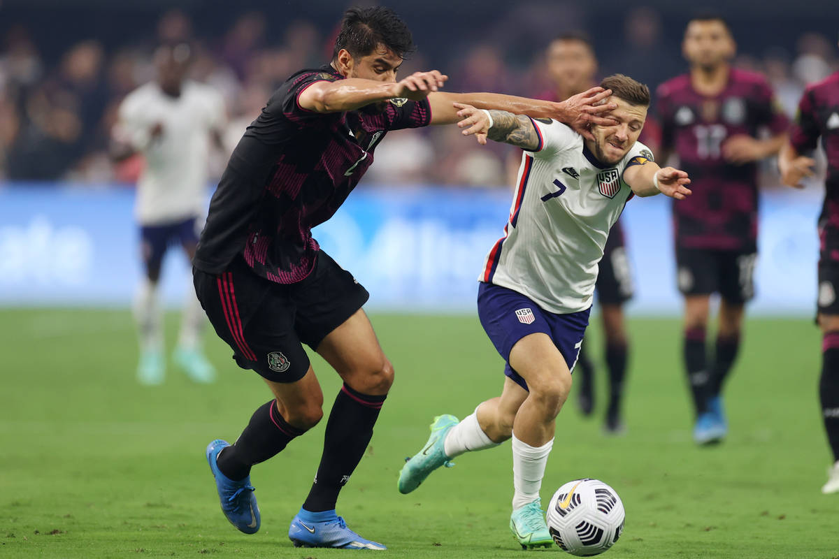 Mexico defender Nestor Araujo pokes the eye of United States forward Paul Arriola (7) before ge ...