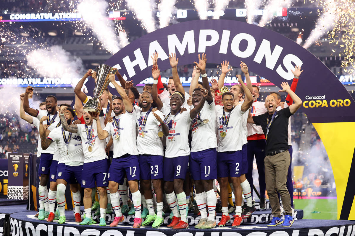 The United States celebrate their victory in the Concacaf Gold Cup final against Mexico at Alle ...