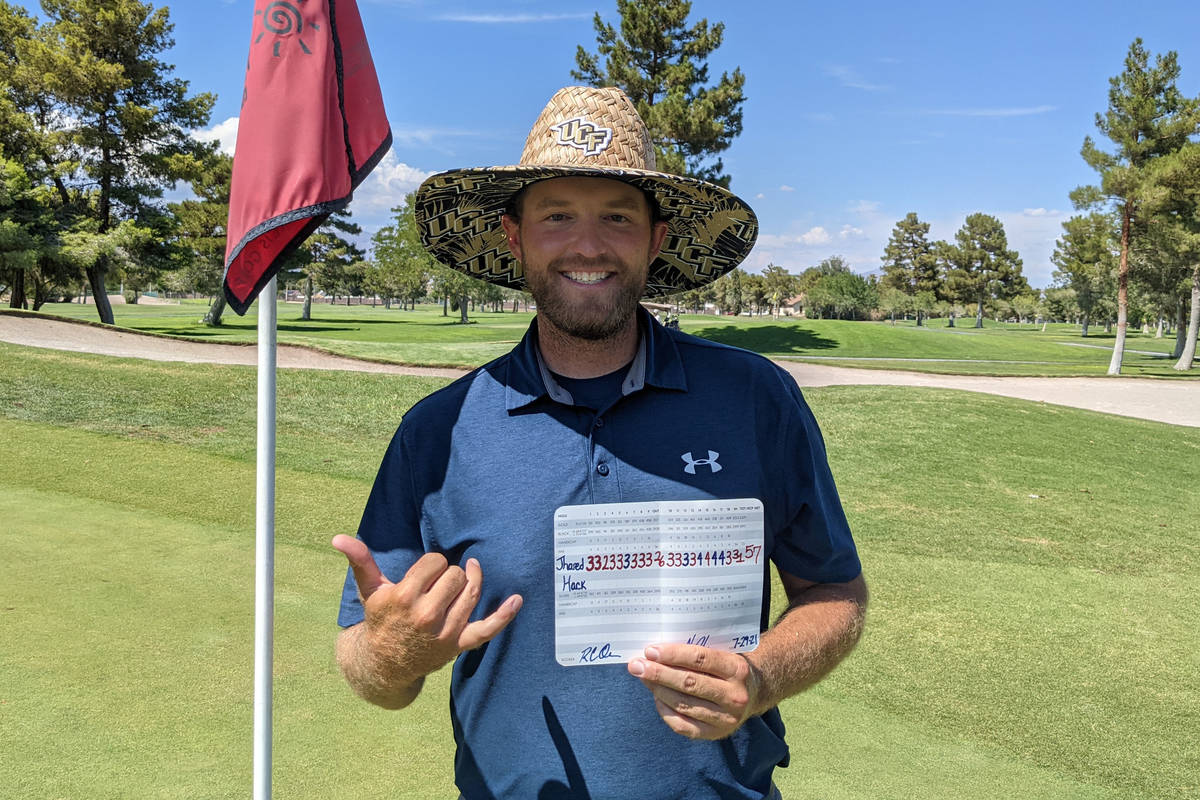 Jhared Hack shows off his scorecard after shooting a 57 last week at Las Vegas Golf Club (Photo ...