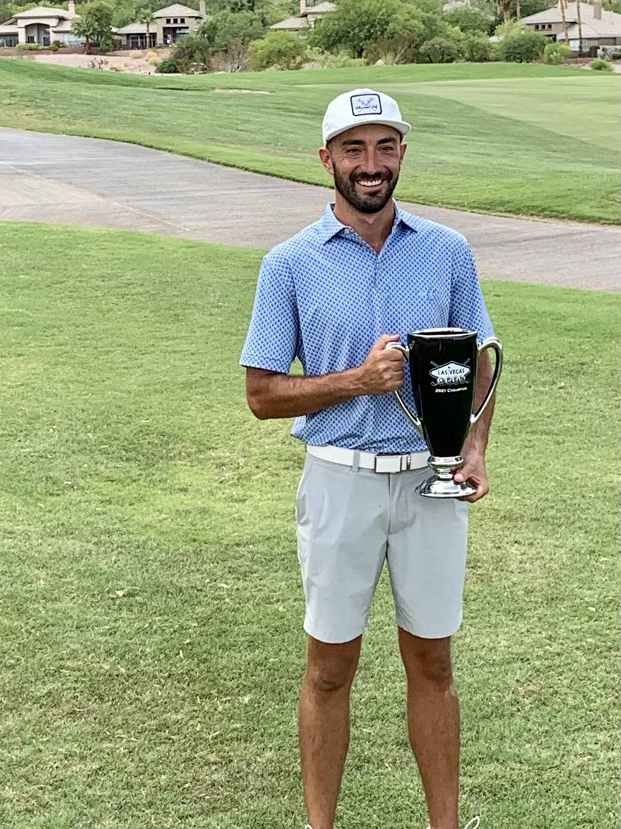 Marty Sanchez displays the trophy on the 18th hole of TPC Las Vegas after winning the inaugural ...