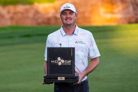 Jason Kokrak celebrates with the trophy after winning the CJ Cup at the Shadow Creek Golf Cours ...