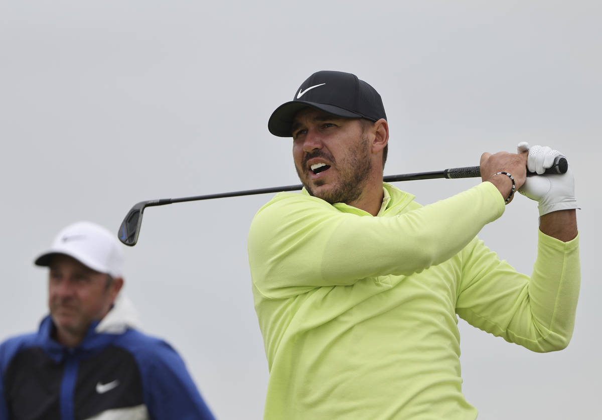 United States' Brooks Koepka tees off the 11th hole during a practice round for the British Ope ...