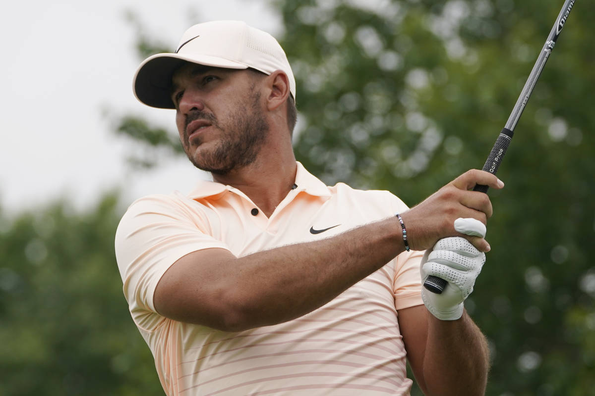 Brooks Koepka watches his tee shot on the second tee during the final round of the Travelers Ch ...