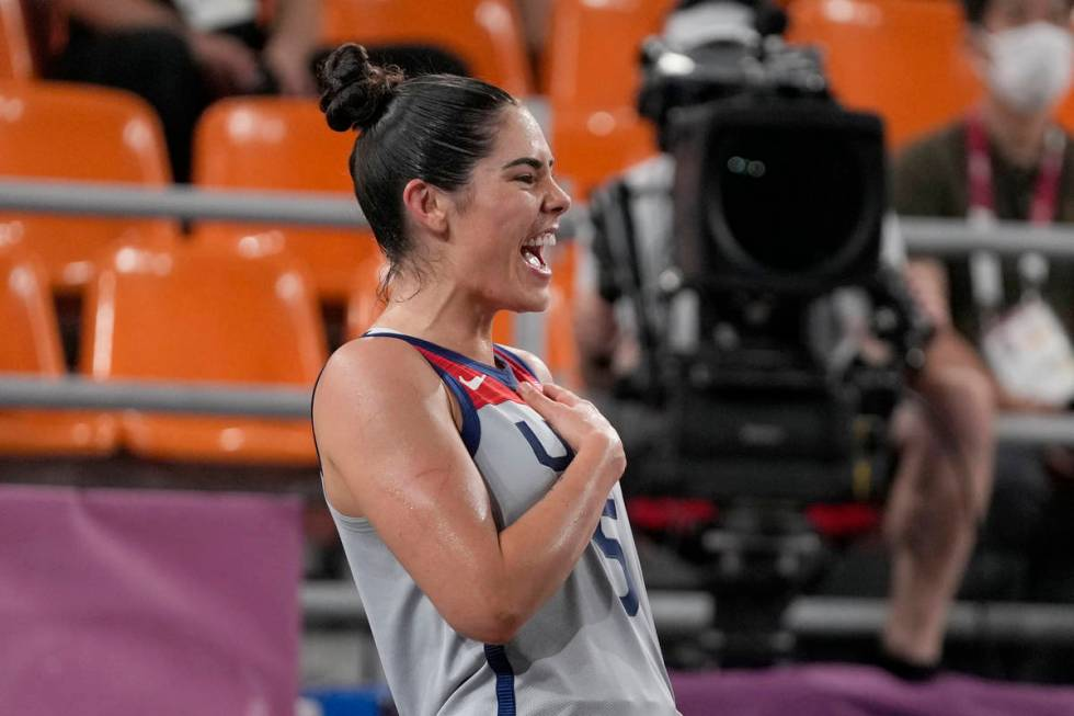 United States' Kelsey Plum celebrates victory over Russian Olympic Committee in a women's 3-on- ...