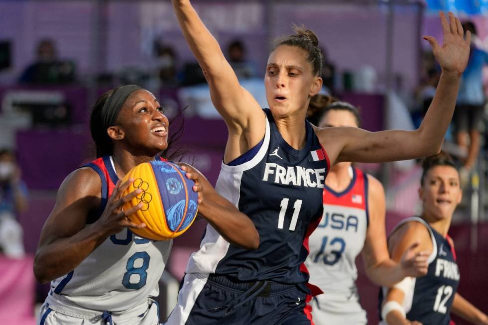 United States' Jackie Young (8) shoots over France's Ana Maria Filip (11) during a women's 3-on ...