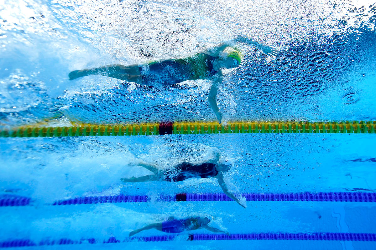 Emma Mckeon, top, of Australia, swims to set an olympic record in a women's 50-meter freestyle ...