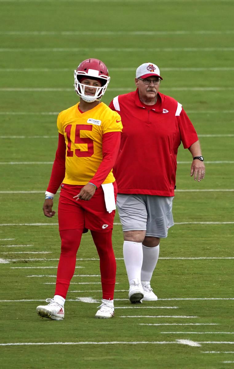 Kansas City Chiefs quarterback Patrick Mahomes (15) and head coach Andy Reid watch teammates du ...
