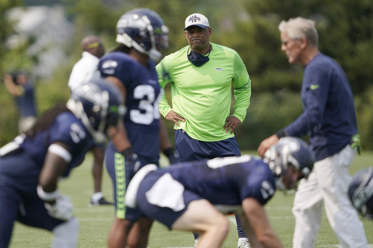 Seattle Seahawks defensive coordinator Ken Norton Jr., center, stands near head coach Pete Carr ...
