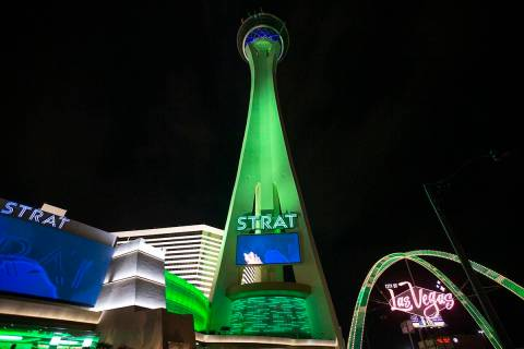 The STRAT and the Las Vegas Boulevard Gateway Arches are lit green for St. Patrick's Day on Wed ...