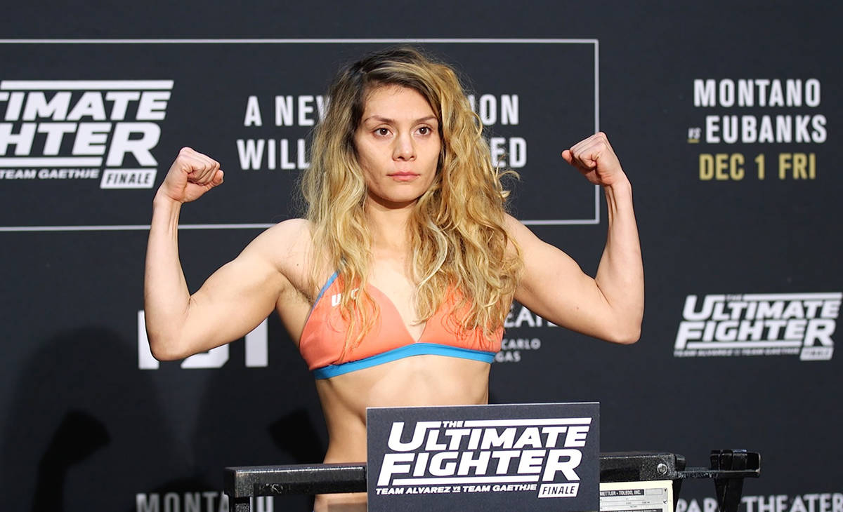 UFC flyweight title contender Nicco Montano on the scale at the TUF 26 Finale official weigh-in ...